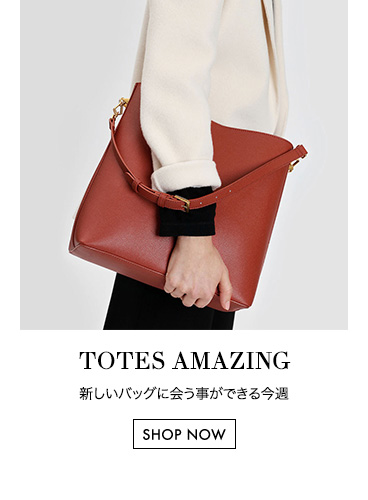 Brick classic bucket bag with a long strap and detachable pouch - Charles & Keith